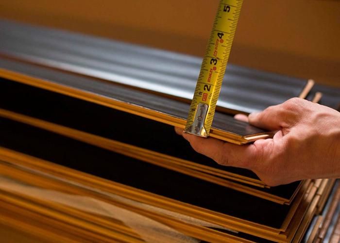 Измерение толщины досок ламината